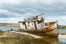 Abandoned Fishing Boat On Beach With Watercolor Effect