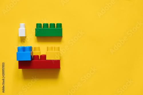 Fototapeta  Colorful plastic building blocks flat lay