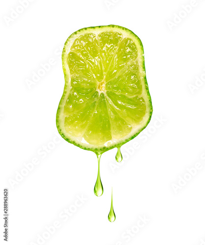 Valokuvatapetti Drops of juice dripping from sliced lime isolated on a white background