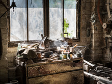 An Abandoned Workshop With Dus...