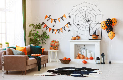 obraz dibond interior of house decorated for Halloween pumpkins, webs and spiders.