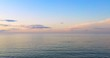 Aerial view wonderful dark silver sea with sunset twilight sky in the evening time. Scenery moment. spirit of serene and zen. image for background, wallpaper, interior