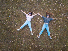 Two Girl Lying In The Grass Ae...