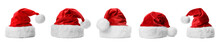 Set Of Red Santa Claus Hats On White Background. Banner Design