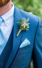 Boutonniere Made With Lavender, Rosemary, And Babys Breath Tied With Twine Pinned To A Blue Jacket, Blue Tie, Wedding Day Clothes