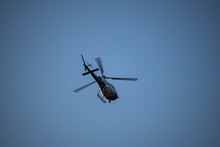 Helicopter Hovers Overhead On ...