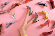 Woman And Different High Heel Shoes On Pink Background, Top View