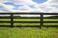 A Wooden Farm Fence Divides Up...