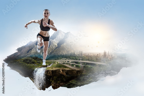 Fotografia  Abstract concept of running young sportswoman