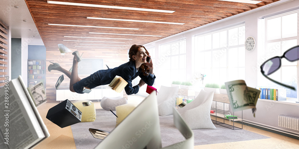 Fototapeta Joyful beautiful young levitating businesswoman