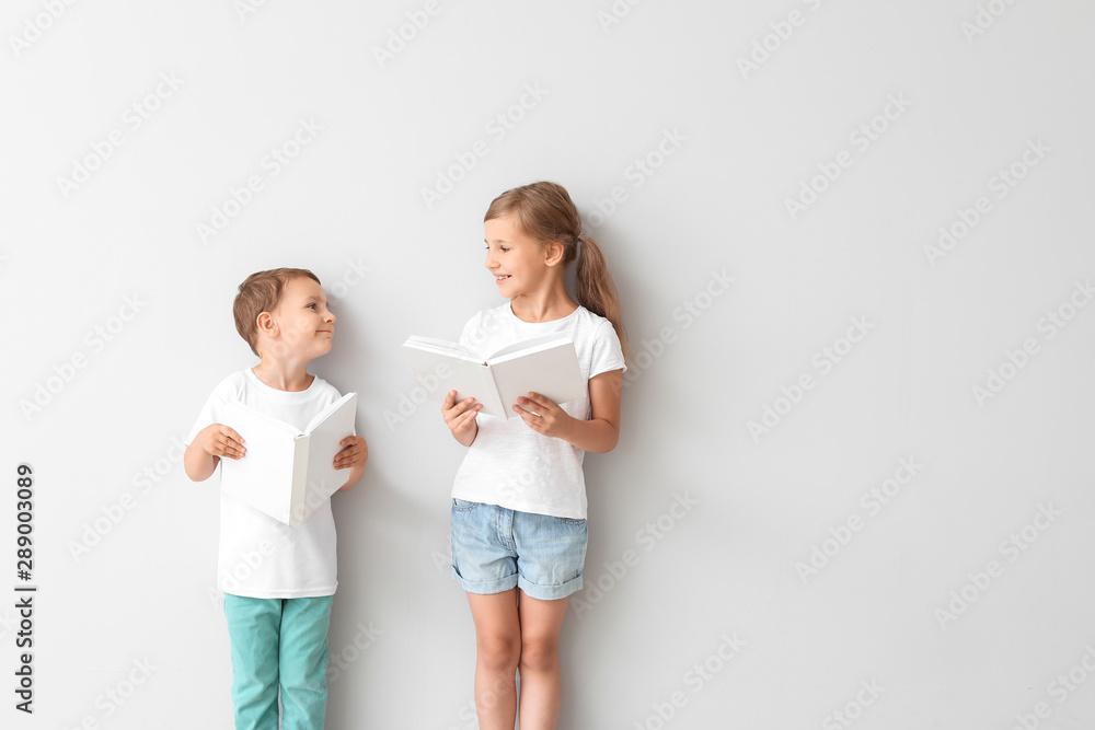 Fototapety, obrazy: Little children with books on light background