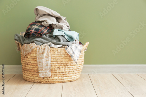 Basket with dirty laundry on floor Wallpaper Mural