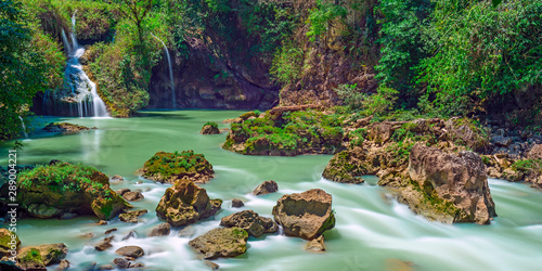 Long exposure panorama of the limestone ridge with cascades and waterfalls of Semuc Champey in the Peten jungle and rainforest of Guatemala.