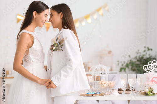 Obraz na plátně Beautiful lesbian couple during wedding ceremony