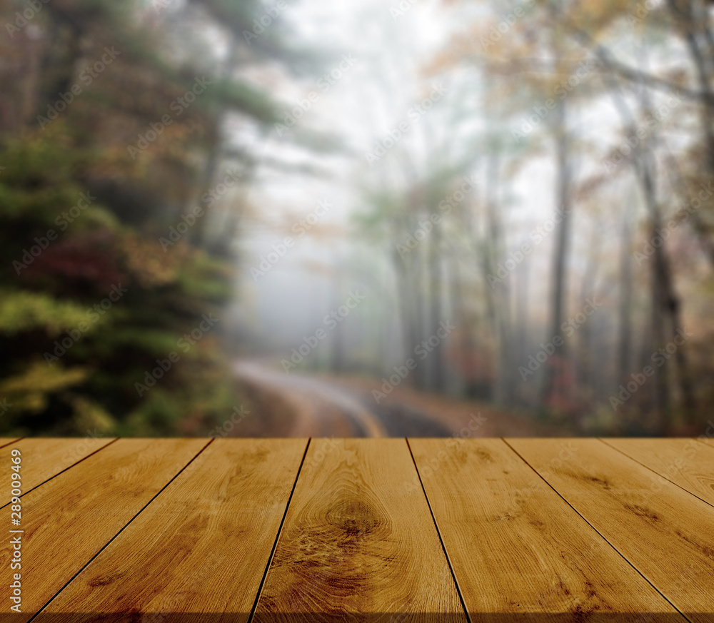 Fototapety, obrazy: Empty wooden table with autumn background.