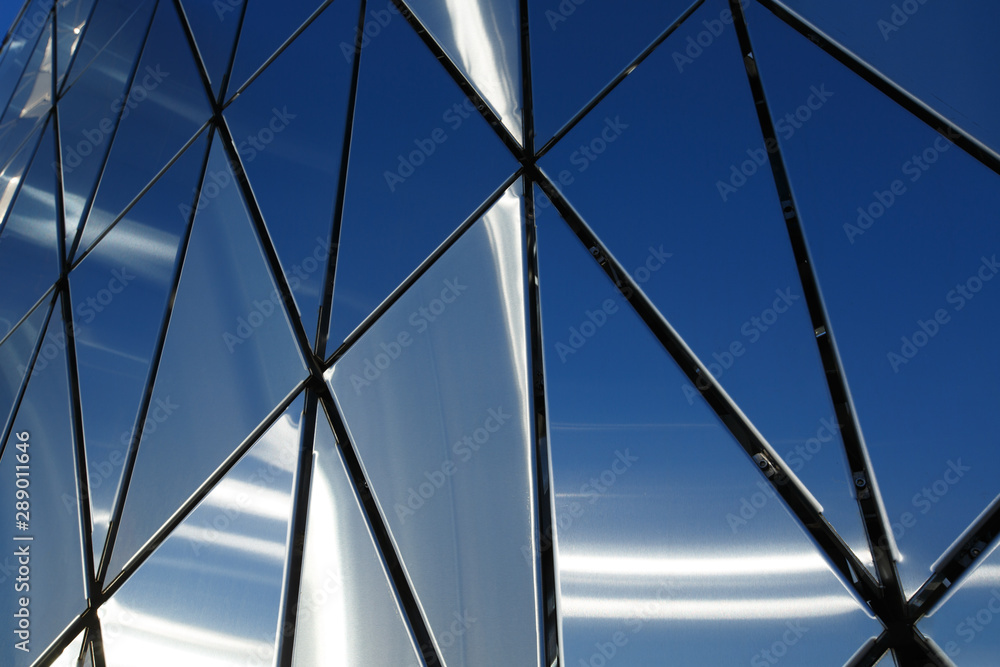 Fototapety, obrazy: Abstract background of polished metal panels of a triangular shape.