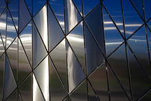 Abstract Background Of Polished Metal Panels Of A Triangular Shape.