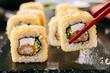Leinwanddruck Bild Crispy Ebi Tempura Maki Sushi Rolls or Uramaki with King Prawn