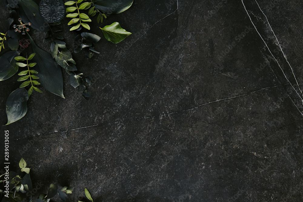 Fototapety, obrazy: Dark green tropical leaves mockup on natural black stone background