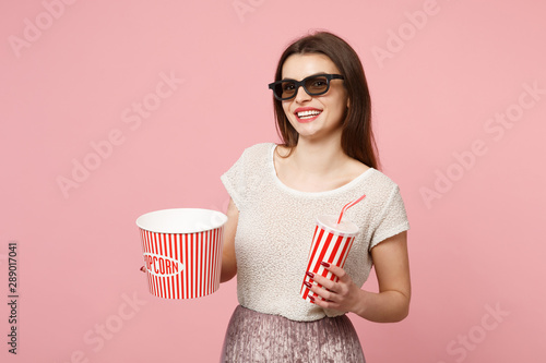 Smiling young woman in 3d imax glasses posing isolated on pastel pink background Wallpaper Mural