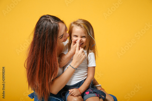 Stampa su Tela  Woman in light clothes have fun with cute child baby girl 4-5 years old