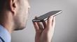 Leinwandbild Motiv Man talking smartphone using the voice recognition.
