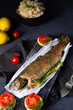 Leinwanddruck Bild baked trout with herb filling and tomatoes