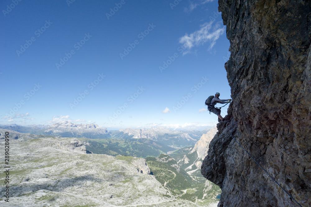 Fototapety, obrazy: attractive female climber on a steep Via Ferrata in the Italian Dolomites