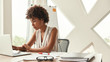 Leinwanddruck Bild - Business expert. Beautiful afro american woman working with laptop while sitting in the modern office