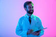 canvas print picture - Portrait of a confident young man doctor wearing uniform