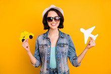 Photo Of Charming Nice Cute Attractive Funky Funny Positive Girl Wearing Cap Jeans Denim Comparing Different Kinds Of Transport While Isolated With Yellow Background