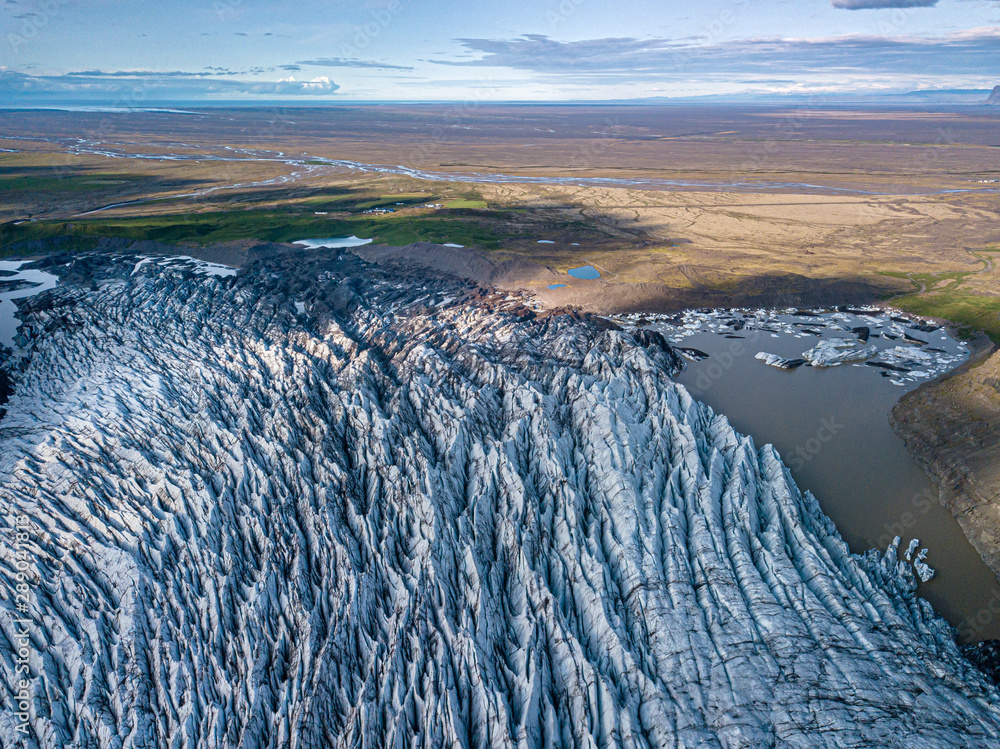 Fototapety, obrazy: Svnafellsjkull Glacier in Iceland. Top view. Skaftafell National Park. Ice and ashes of the volcano texture landscape, beautiful nature ice background from Iceland