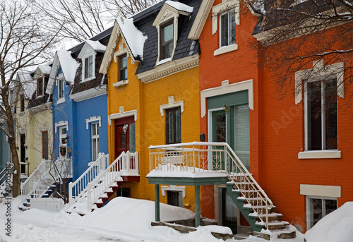Victorian colourful houses taken in Montreal, Canada © gdvcom