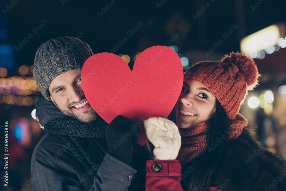 Fototapeta Close-up portrait of his he her she nice attractive charming lovely cheerful cheery couple wearing warm outfit holding in hands sharing big large heart 14 February outdoors