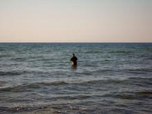 Fisherman In Sunset