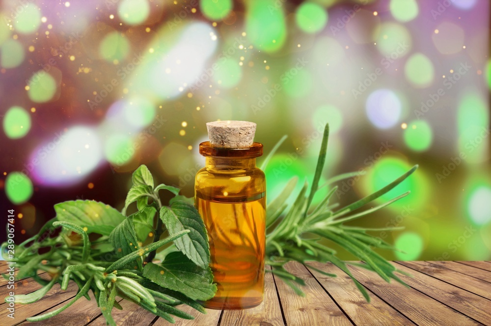 Fototapeta Essential Oil with Rosemary Sprig Isolated