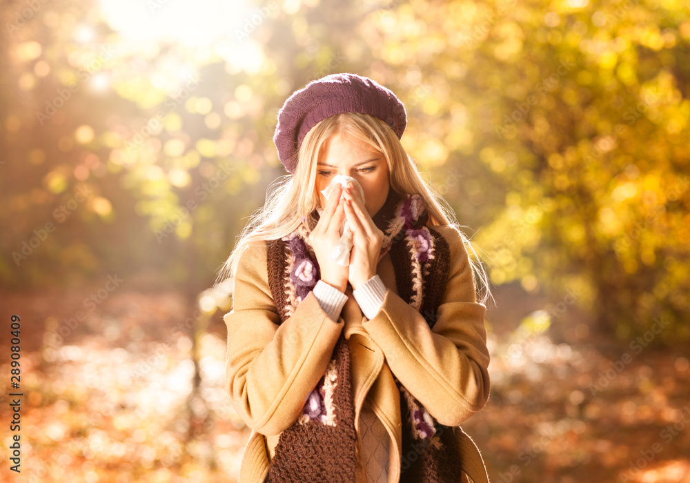 Fototapety, obrazy: Woman coughing and blowing her nose in autumn