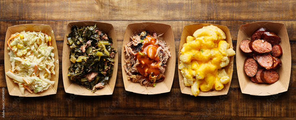 Fototapety, obrazy: assorted trays of texas bbq with collard greens, hotlinks, pulled pork, mac and cheese, coleslaw