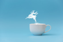 Steam In Reindeer Shape Flying From Coffee Cup. Morning Drink. Christmas Or New Year Celebration Concept. Copy Space.