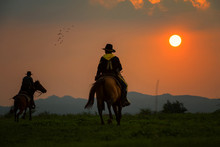 The Silhouette Of Two Cowboys,...