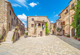 Fototapeta Uliczki - Montemerano (Italy) - The awesome historical center of the medieval and renaissance stone town in Tuscany region, on the hill; province of Grosseto.