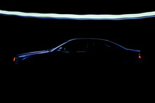 Fast Business Luxury Prestige Car Lit In The Dark