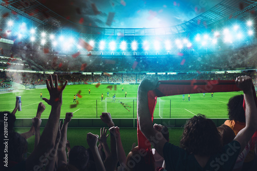 Football scene at night match with cheering fans at the stadium Wallpaper Mural