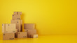 canvas print picture - Pile of cardboard boxes on the floor on a yellow background