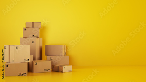 Obraz Pile of cardboard boxes on the floor on a yellow background - fototapety do salonu