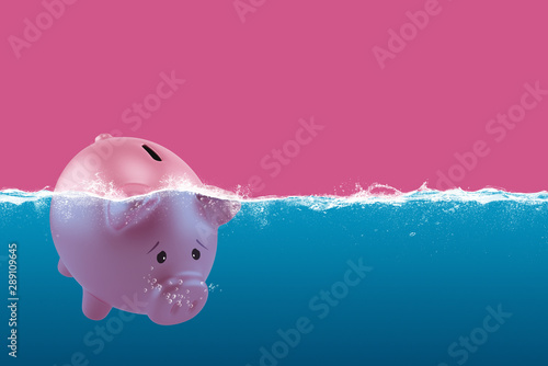 Tuinposter Europa Lonely piggy bank sails in bad waters due to the crisis