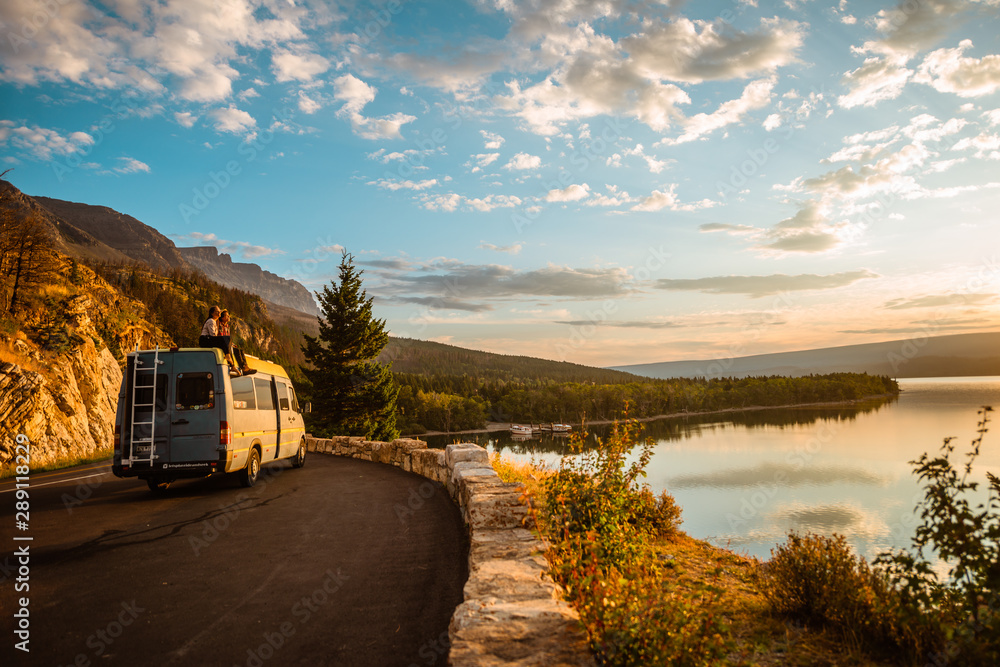Fototapety, obrazy: Women enjoying camper van with a view of a lake