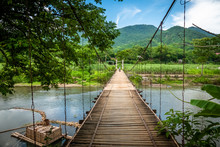 Wooden Hanging Suspension Bridge Over The River In Pu Luong, Mai Chau Area, North Vietnam.