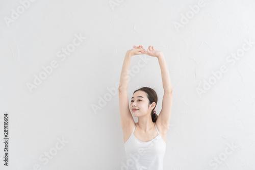 Obraz na plátně ストレッチ・体操をする女性