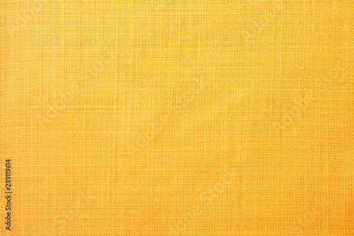 Fototapeta Yellow linen fabric of table cloth texture background obraz